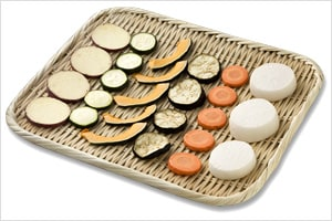 Vegetables spread out on a bamboo basket to dry